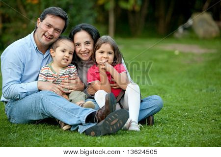 Beautiful family portrait smiling and having fun outdoors
