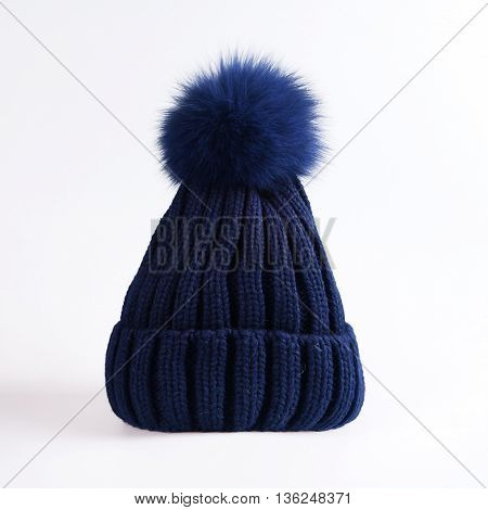 blue Knitted hat with bubo over white