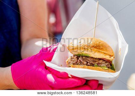 chef preparing a gourmet burger