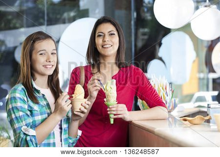 Smiling Mother And Daughter With Vanilla Ice Creams
