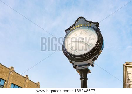 JERSEY CITY, NJ - CIRCA MARCH, 2016: clock in Jersey City at daytime. Jersey City is the second most populous city in the U.S. state of New Jersey after Newark.