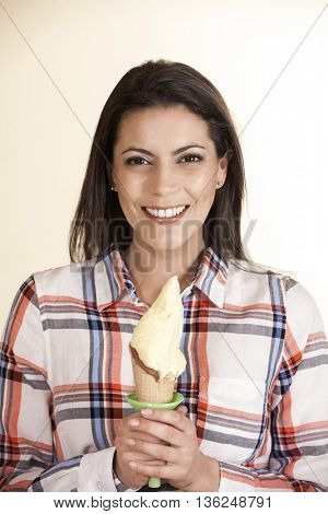 Smiling Mid Adult Woman Holding Vanilla Ice Cream Cone