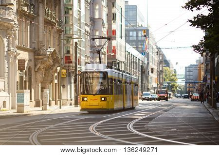 Berlin Germany - June 26 2016: Yellow tram in Berlin Mitte Germany. Tramway public transport