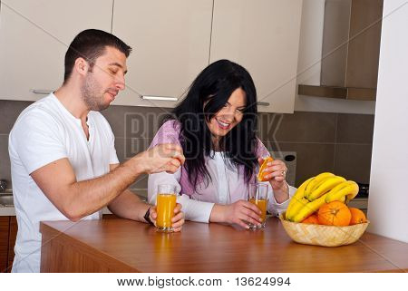 Couple Make Fresh Orange Juice