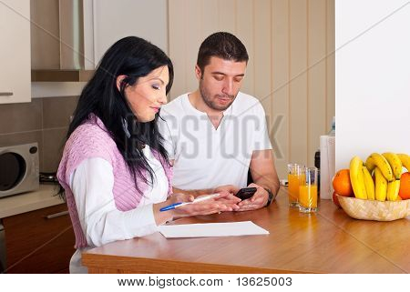 Mid Adult Couple Calculating