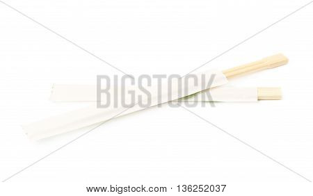 Wooden sushi chopsticks in a protection paper sleeve, isolated over the white background