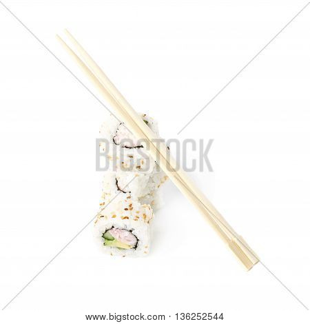 Composition of multiple California maki sushi with the wooden chopsticks over it, isolated over the white background