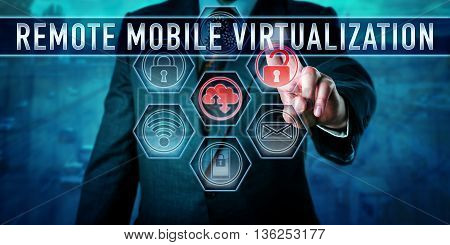 Male corporate user is pushing REMOTE MOBILE VIRTUALIZATION on an interactive virtual touch screen monitor. Business metaphor and information technology concept for centralized computing practices.