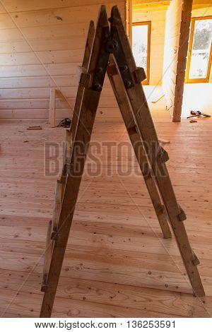 wooden ladder stand-up in a wooden house