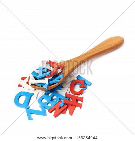 Pile of painted red, blue and white wooden letters with the wooden serving spoon over it, composition isolated over the white background