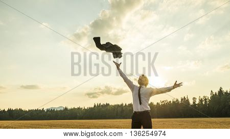 Happy Successful Businessman Throwing His Coat in the Air for being Free of Something with Wide Open Arms.
