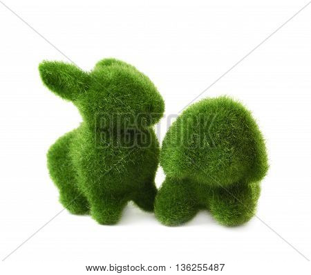 Toy animal statuettes made of plastic green grass as an Easter decoration, composition isolated over the white background