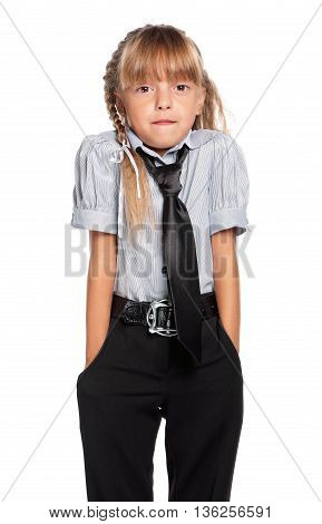 Shocked schoolgirl posing isolated on white background. Back to school concept.