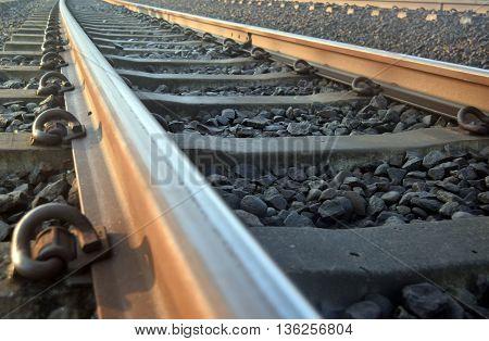 railway lines in the morning sun illuminated