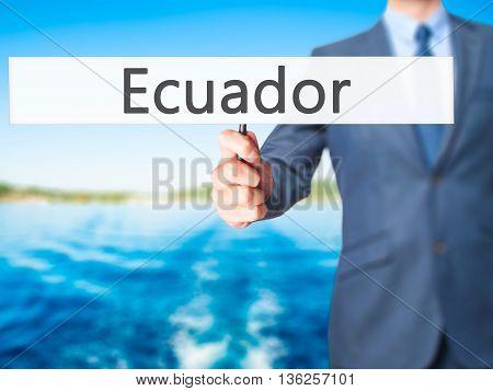 Ecuador - Businessman Hand Holding Sign