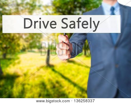 Drive Safely - Businessman Hand Holding Sign