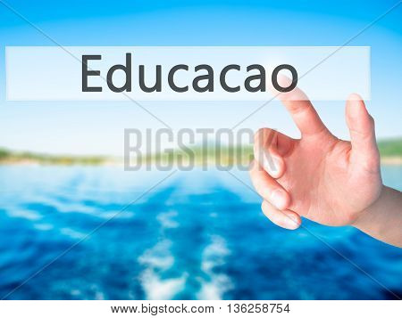 Educaco (education In Portuguese) - Hand Pressing A Button On Blurred Background Concept On Visual S