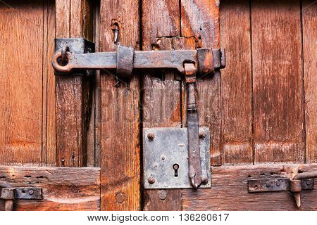 wooden door closed on the lock and latch