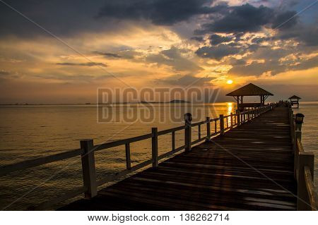 Landscape Of Wooded Bridge In The Port Between Sunsets