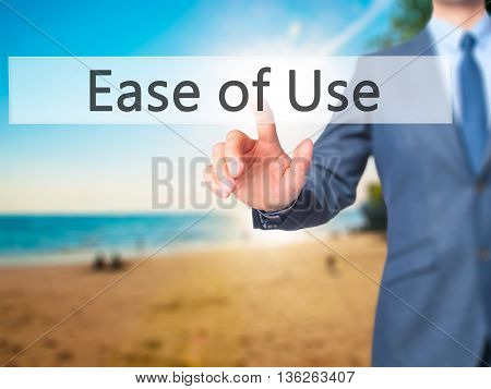 Ease Of Use - Businessman Hand Pressing Button On Touch Screen Interface.