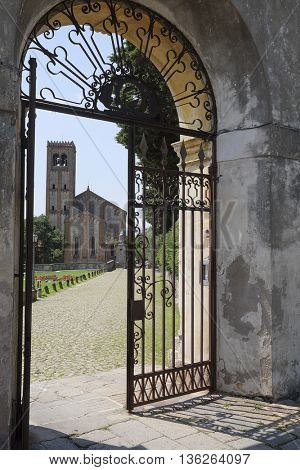 Veiw from a gates to a cathedral in an old part of  Monselice, Italy
