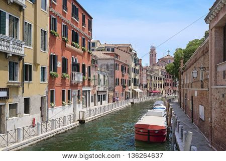 Landscape with the image of boats on a channel in Venice, Italy