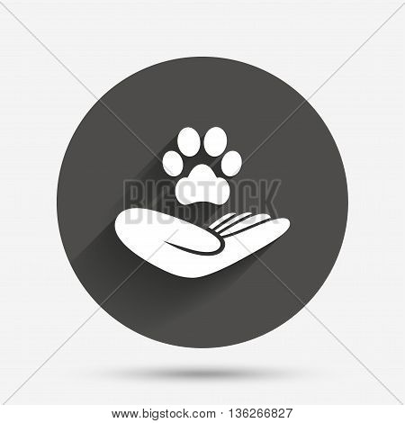 Shelter pets sign icon. Hand holds paw symbol. Animal protection. Circle flat button with shadow. Vector