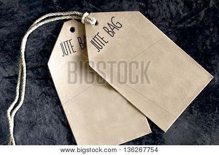 Two brown retail price tags for a shop.