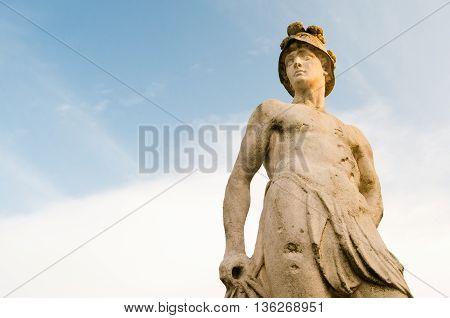 Ornamental white stone statue along the main avenue of Querini park in Vicenza