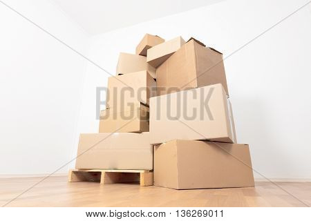 Boxes in empty room, moving in new apartment