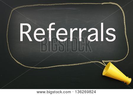 megaphone and speech bubble with text referrals