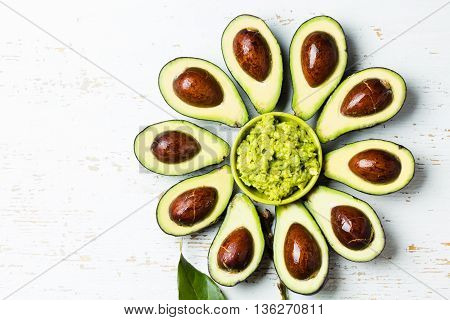 Avocado. Flower made from avocado and guacamole bowl on white background. Top view. Copy space