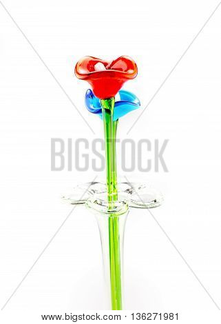Flower Made Of Glass In Red And Blue Color In Vase On White Background