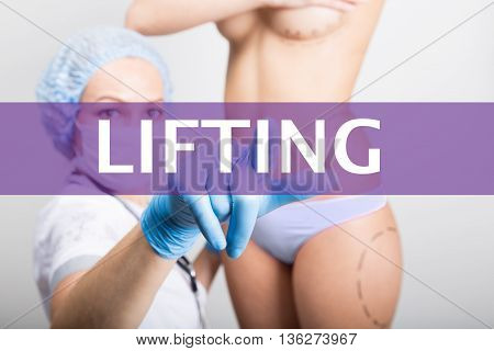 technology, internet and networking in medicine concept - medical doctor presses lifting button on virtual screens. cosmetic surgery, lifting and breast augmentation.
