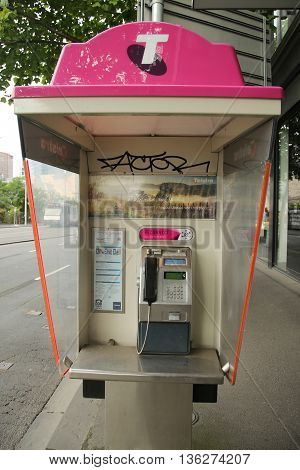 MELBOURNE, AUSTRALIA - JANUARY 24, 2016: Old style Telstra Payphone in Melbourne, Australia. Telstra switches on public Wi-Fi hotspots, offering free access.