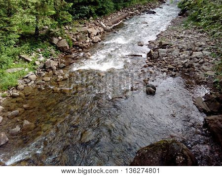 Mountain river and green grass natural background