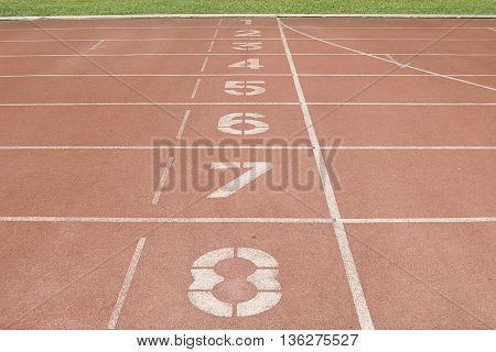 red running track in stadium at starting pointrunning track line