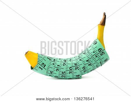 fresh banana wrapped with measuring tape with clipping path concept of mens penis length & health as well as food for fitness & diet