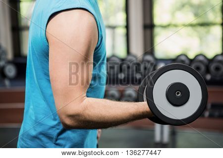Man working out with dumbbell at gym
