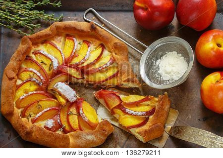 Fruit pie with peaches nectarines cinnamon and thyme. Summer dessert for gourmets. Selective focus
