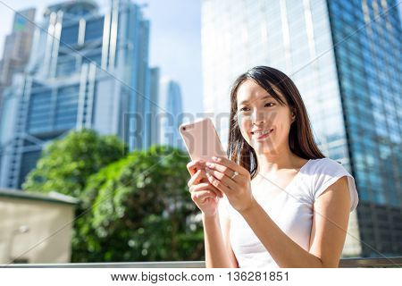Woman use of cellphone in Hong Kong city