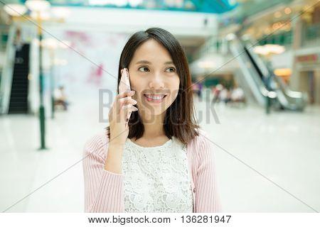 Woman having conversation on mobile phone
