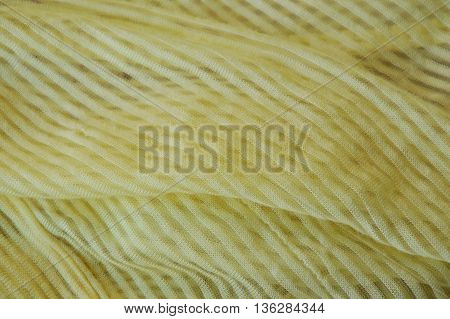 close up of yellow slip cloth texture and background