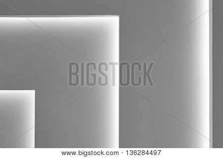 Grey wall with gradient light decoration in angle. Horizontal