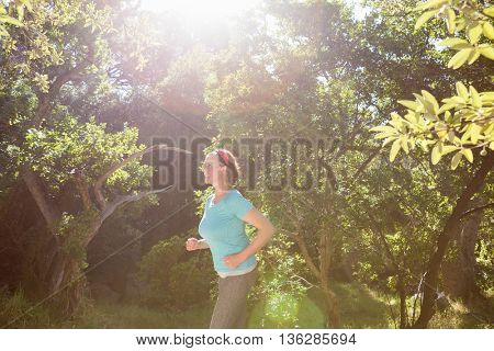 Woman running on the wood