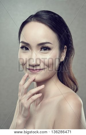 Portrait of beautiful smiling Chinese woman looking at camera