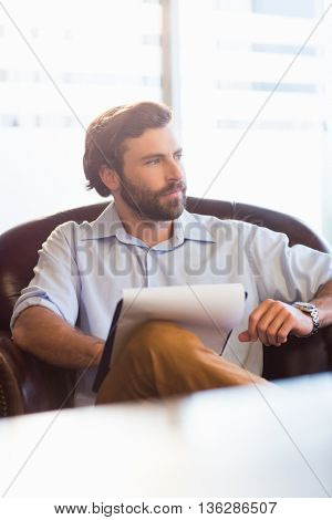 A businessman taking notes at work