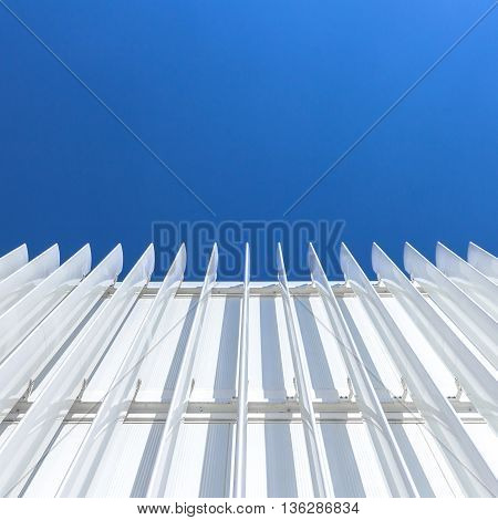 Abstract perspective of the facade of a modern building covered with white panels