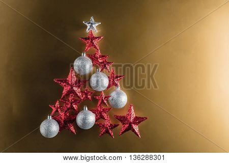 Christmas Tree Shape With Red Stars And Silver Baubles