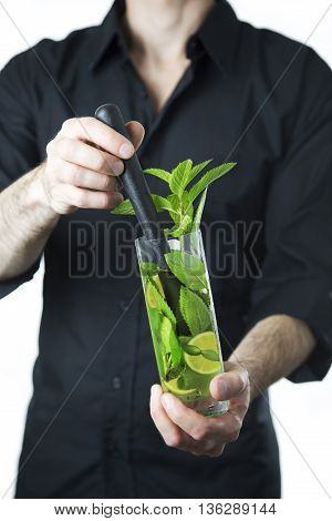 isolated on white portrait of barman with mojito